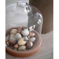 Glaskupa med hål i toppen och terrakottabotten